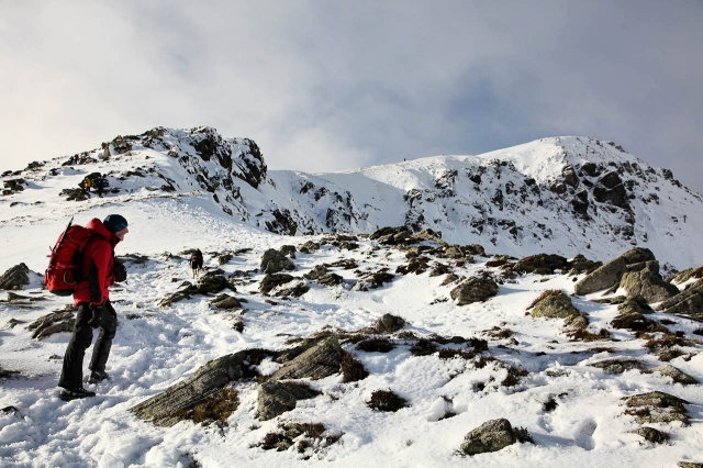 The author pressing on with the summit slopes of Pen yr Ole Wen above ….  (JB)