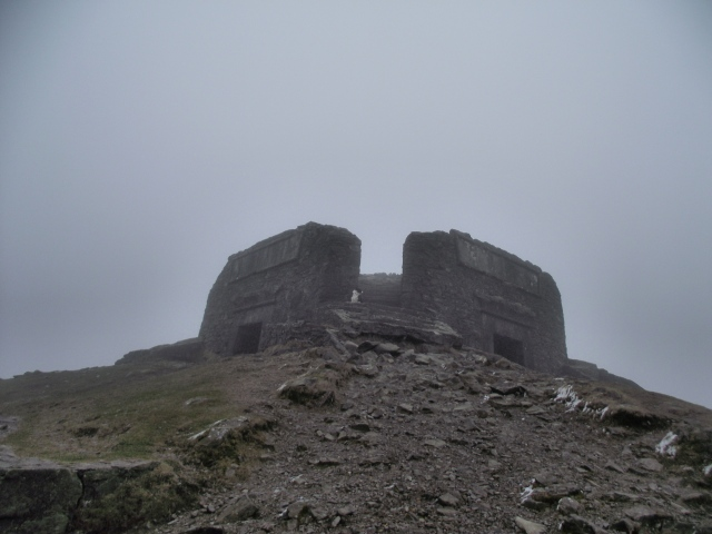 At the summit of Moel Famau in cold, dank conditions