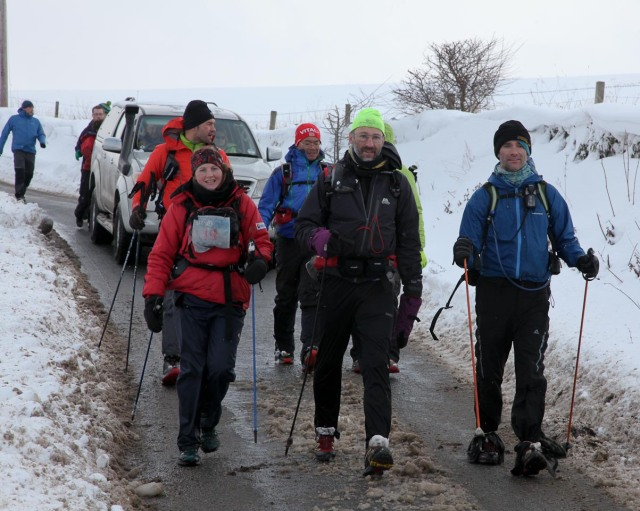 Annabell, Ian, Brian, Thomas and Jin walking to the finish, heads held high (Spine)