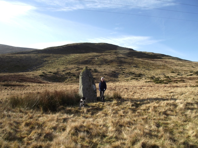 Chris next to the 3 metres high standing-stone at Bwlch y Ddeufean