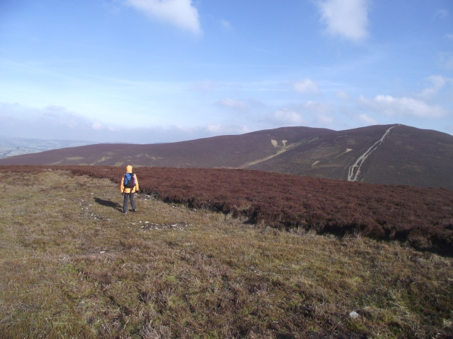 Chris on the faint remains of an Iron Age hut platform on Moel y Gaer