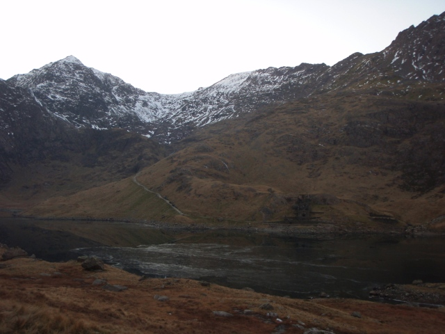 Looking back to Yr Wyddfa and the Miners Track above a frozen Llyn Llydaw