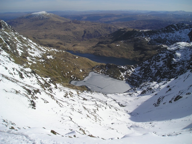 Looking down to the frozen lake of Glaslyn below Yr Wyddfa (Snowdon)