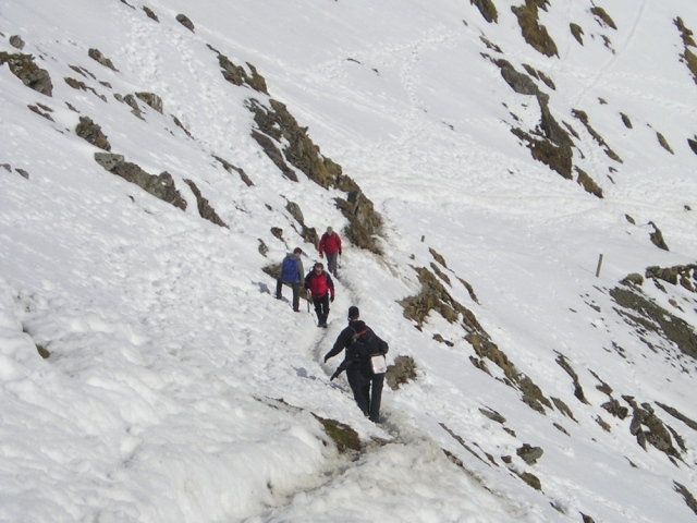 Walkers at the top of the PYG Track, Snowdonia