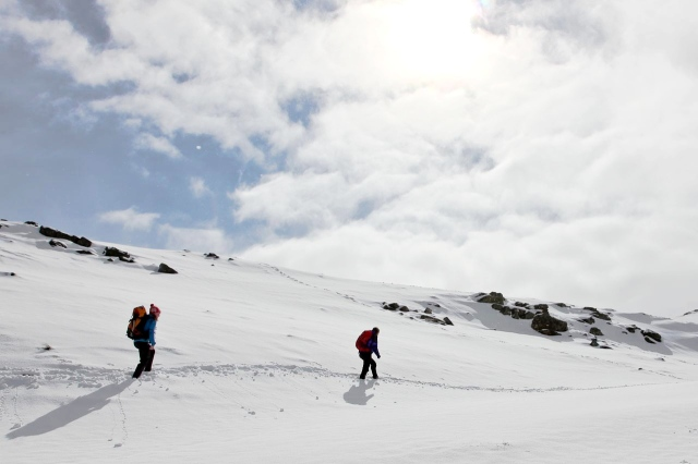 Naomi and Olivia ploughing through fresh snow near Red Tarn