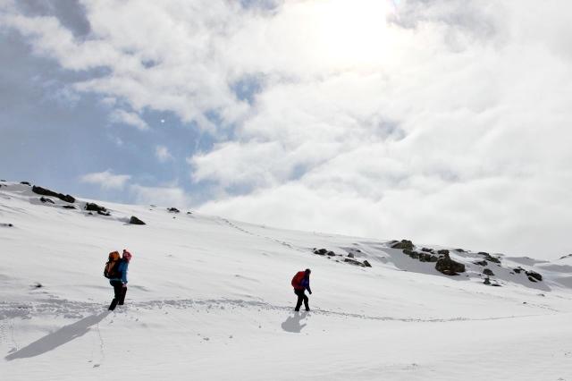 Naomi and Olivia ploughing through fresh snow near Red Tarn