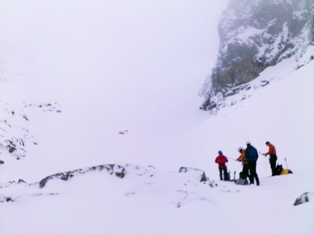 Checking the snowpack below No 5 Gully, Ben Nevis
