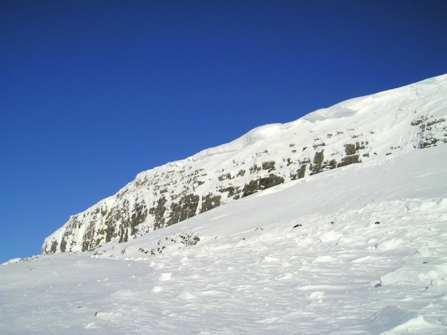 Cornices on Pen y Ghent crag in the Yorkshire Dales, with some evidence of avalanche debris