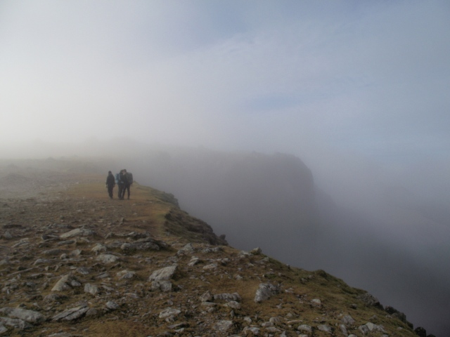 Walkers above the headwall of Cwm Cneifion