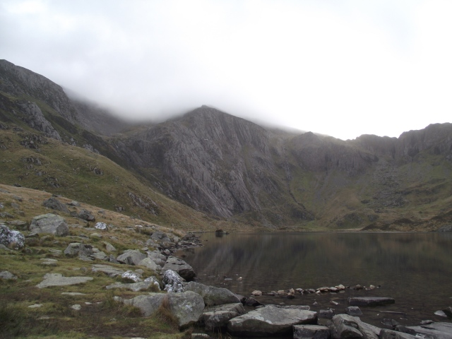 The lake of Llyn Idwal, with Idwal Slabs centre and Seniors Ridge running above the top left of the slabs