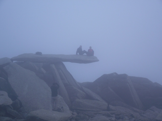 A misty view of the Cantilever Stone on Glyder Fach
