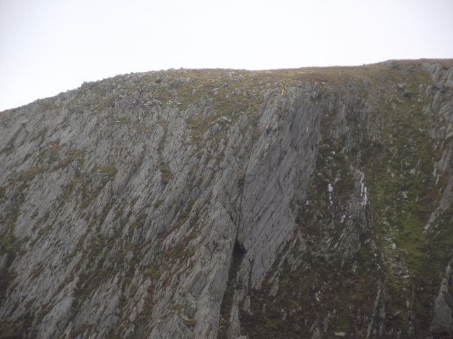 Climbers (just visible) finishing the top pitch of 'Cneifion Arête'
