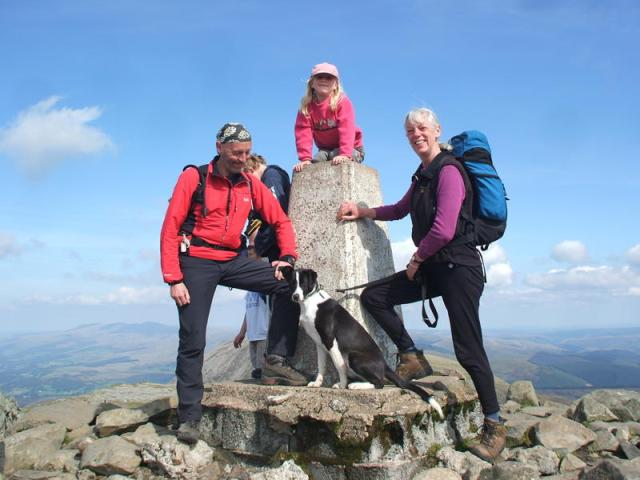 The author and Chris at the summit, with Border Collie Meg and 'summiteer' Tessa