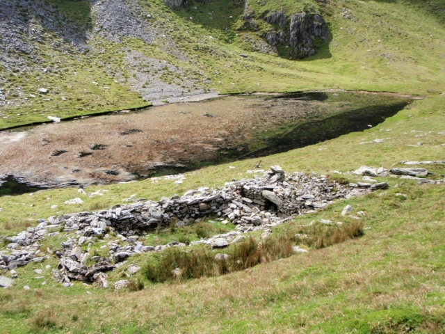 The ruins of the hafod, thought to have once been the highest in Wales, next to the small lake