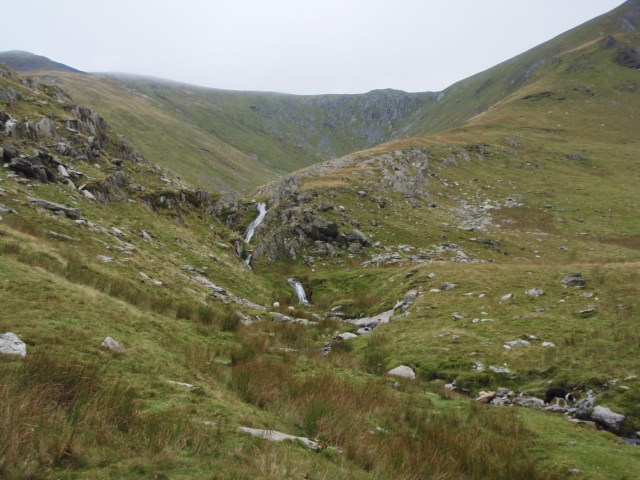 Waterfall in the upper reaches of the narrowed valley ….