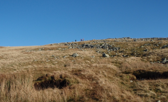Walkers on the ridge above