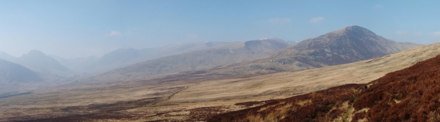 The southern mountains of the Carneddau with Tryfan just creeping in through the haze  (far left)