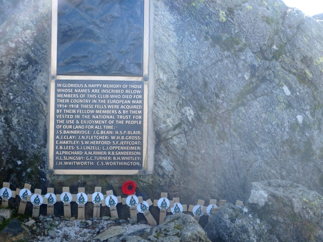 Closer view of the memorial, with recent tributes bearing the Royal Marines crest