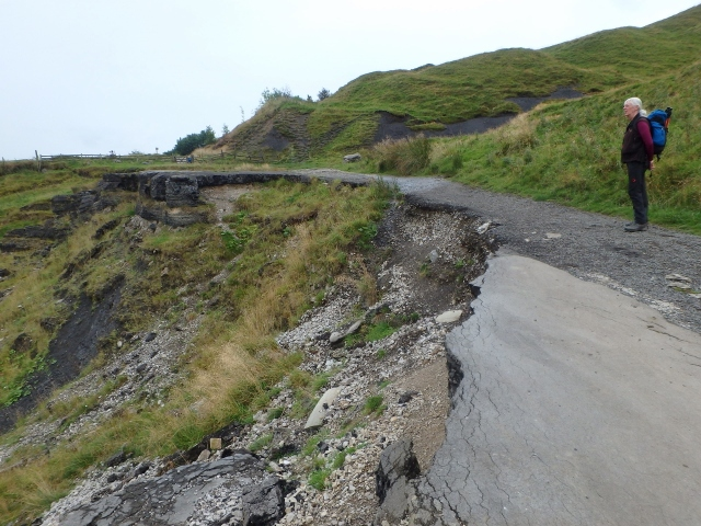 The road almost completely swept away at this point