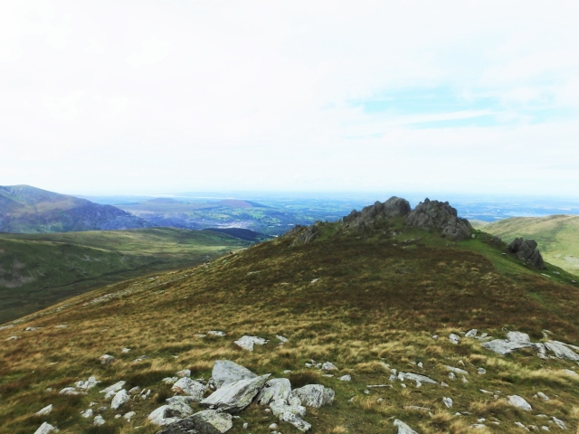 Looking back at the rocky top of Foel Ganol