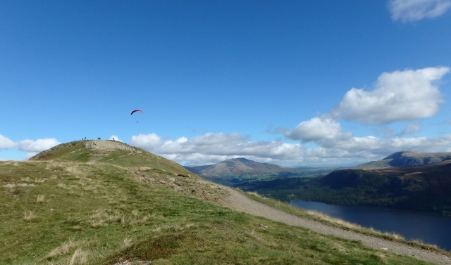 Paraglider pilot having fun over Cat Bells summit
