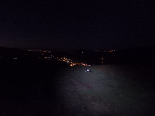 …. with the lights of Llanberis below and my headlight reflecting on the dog's harness